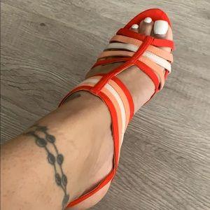 Different shades of orange heels